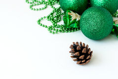 Green Christmas balls and fir-cone. Stock Photography