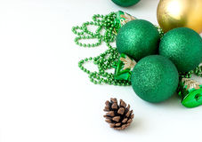 Green Christmas balls and fir-cone. Royalty Free Stock Photography