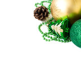 Green Christmas balls and fir-cone. Stock Image