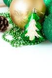 Green Christmas balls and fir-cone. Royalty Free Stock Photos