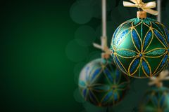 Green christmas balls hanging on abstract background Royalty Free Stock Photo