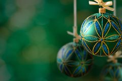 Green christmas balls hanging on abstract background Royalty Free Stock Image