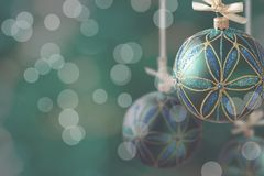 Green christmas balls hanging on abstract background Royalty Free Stock Images