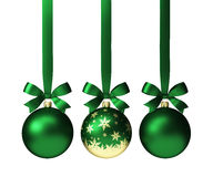 Green christmas balls hanging on ribbon with bows, isolated on white
