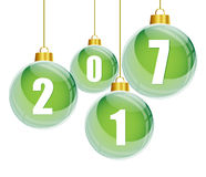 Green christmas balls with the numbers of new year 2017. Hanging on white background royalty free illustration