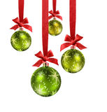 Green Christmas balls red ribbon. Decorated green christmas balls hanging in red silk ribbons with knot and bow stock photos