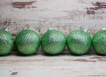Green christmas balls in a row Royalty Free Stock Image