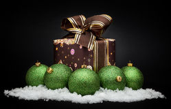 Green christmas balls with snow. Gold christmas balls with snow Royalty Free Stock Photo