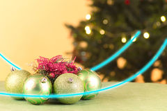 Green Christmas balls with tree and lights Royalty Free Stock Photos