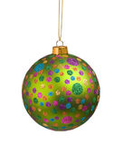 Green Christmas bauble with colorful dots Stock Photos