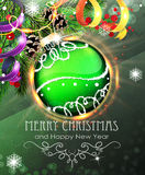 Green Christmas bauble with fir branches and tinsel Stock Photo