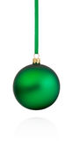 Green Christmas bauble hanging on ribbon Isolated on white backg Royalty Free Stock Photos