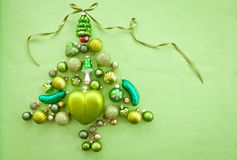 Green christmas baubles. Arranged in a tree shape Royalty Free Stock Photography