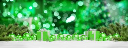Green christmas baubles and gifts lined up 3D rendering. Green christmas gifts and baubles lined up on green background 3D rendering vector illustration