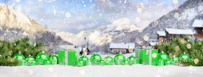 Green christmas baubles and gifts lined up 3D rendering. Green christmas gifts and baubles lined up on mountain background 3D rendering stock illustration