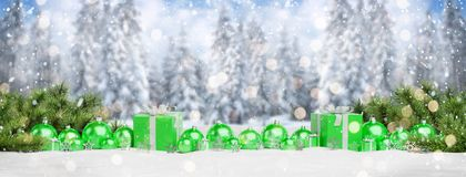 Green christmas baubles and gifts lined up 3D rendering. Green christmas gifts and baubles lined up on mountain background 3D rendering royalty free illustration