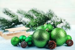 Green christmas baubles. With cones on wooden table Stock Photos