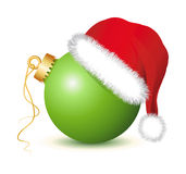 Green Christmas baubles with Santa Claus Hat. Golden Christmas ball, Christmas ball , Christmas baubles, santa claus hat, red hat, red cap,   fir twigs Stock Photography