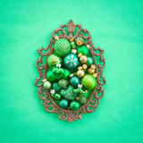 Green christmas baubles stock images