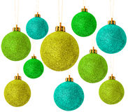Green christmas baubles on white Stock Images