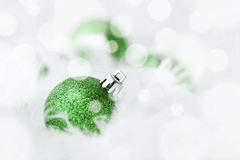 Green Christmas Baubles. In white feather Stock Photo