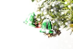 Green Christmas bell decoration hanging from Christmas tree. royalty free stock photo