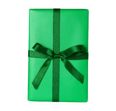 Green christmas or birthday gift - isolated. Green christmas or birthday gift package with green ribbon bow - isolated on white Royalty Free Stock Image