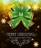 Green Christmas bow on holiday background. Green Christmas bow on abstract background with sparkling lights Stock Photo