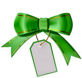 Green Christmas bow with label. On white background Royalty Free Stock Photos