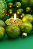 Green Christmas Candle. Green Holiday Candle with christmas decoration and copy space Royalty Free Stock Image