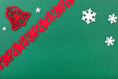 Green christmas card with bell and stars Stock Images