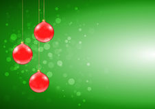 Green Christmas card with shiny red baubles. And sparkles Royalty Free Stock Photo