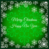 Green Christmas card with snowflakes. Green Christmas card with closeup silhouette of snowflake in the center and white snowflakes around Royalty Free Stock Photo