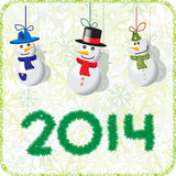 Green Christmas card snowmen 2014. Green Christmas card with snowmen 2014 Royalty Free Stock Images