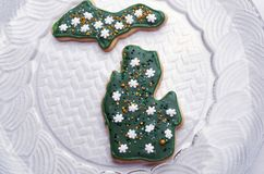 Green Christmas Cookie Cut Out Of Michigan, Upper and Lower Peninsula. Christmas cut out cookie in the shape of the state of Michigan with both upper and lower Royalty Free Stock Photography