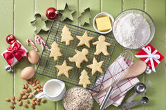 Green Christmas Holiday Cookies Baking. Christmas cookies with baking utensils, ingredients and Xmas presents on a rustic green wood background stock image