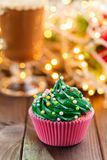 Green christmas cupcake with bokeh on background stock photography