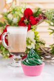 Green christmas cupcake with star sprinkles in pink cup stock images