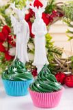 Green christmas cupcakes with decorations royalty free stock photos