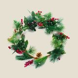 Green Christmas Decorative Wreath Holly Berries. Green Christmas Decorative Wreath with Holly Berries Beige Background Happy New Year Greeting Card Winter Xmas stock photo