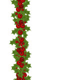 Green Christmas garlands of holly and mistletoe Royalty Free Stock Photos