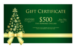 Green Christmas gift certificate with Christmas tr Stock Photos