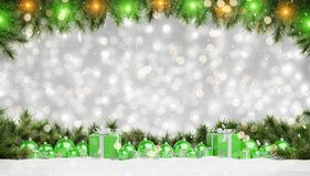 Green christmas baubles and gifts lined up 3D rendering. Green christmas gifts and baubles lined up on grey snowy background 3D rendering royalty free illustration