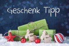 Green Christmas Presents, Snow, Geschenk Tipp Means Gift Tip stock images