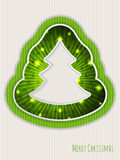 Green christmas greeting with bursting christmas tree Royalty Free Stock Photos