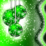 Green Christmas greeting card. Christmas illustration with colorful green balls and snowflakes. Christmas Greeting Card 2015.Bright winter background with Stock Image