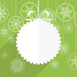 Green Christmas greeting card with white christmas bauble Royalty Free Stock Images