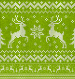 Green Christmas knit with deers seamless pattern Royalty Free Stock Photos
