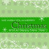 Green Christmas and New Year`s postcard. Green postcard with snowflake decorative symbols and the text we wish you a Merry Christmas and a Happy New Year written royalty free illustration