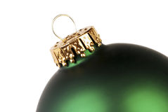 Green Christmas Ornament. Close-up of part of a green Christmas ornament on a white background Stock Image